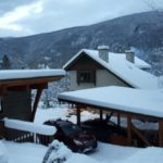 view of the vacation rental in snow